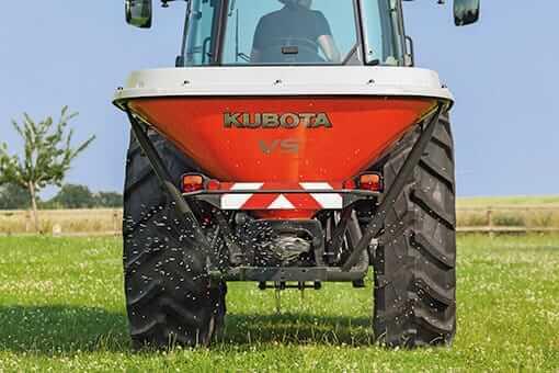 Compact Tractor Seeder : Kubota vs compact tractor pendulum spreader attachment